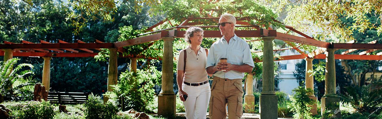 couple walking in a garden