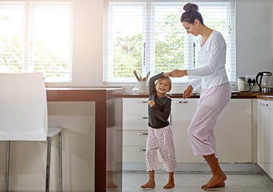 Daughter and mom in kitchen