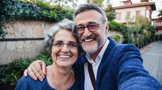 Tourist senior couple taking a selfie