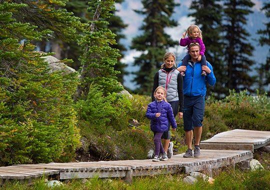 family walking on mountain trail