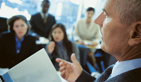 businessman talking to group of colleagues