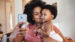 young woman taking a selfie with her baby girl