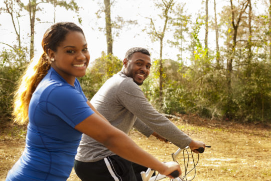young sporty couple on bike ride