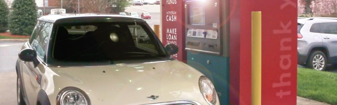 cream mini cooper at Allegacy drive-thru ITM