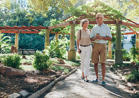 couple walking in a garden