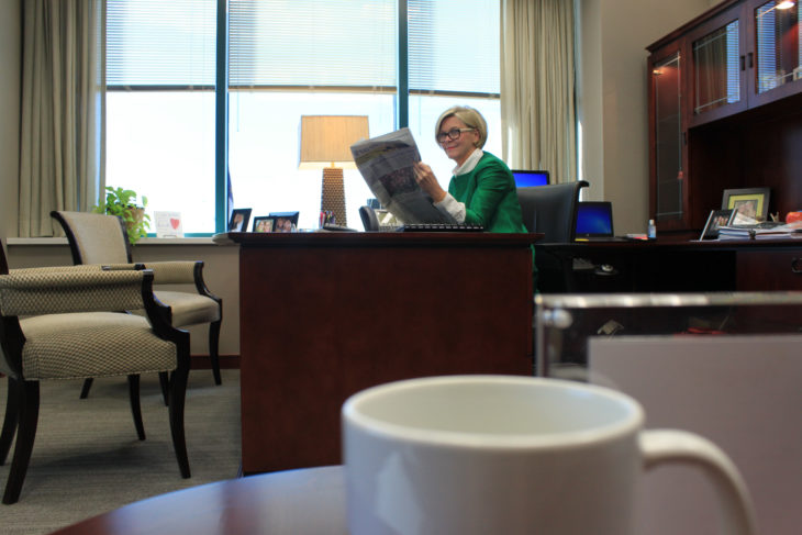 Allegacy CU CEO Cathey Pace sitting at her desk.