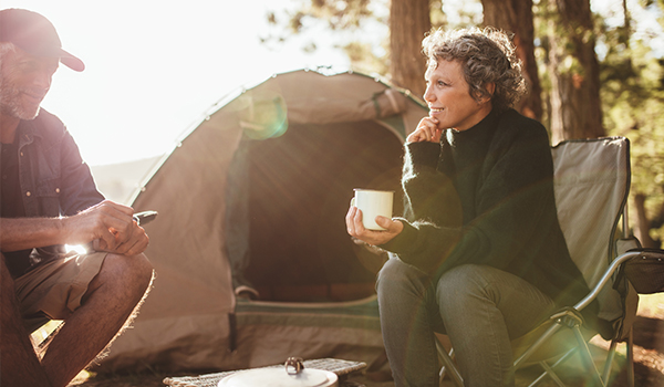 couple camping in woods